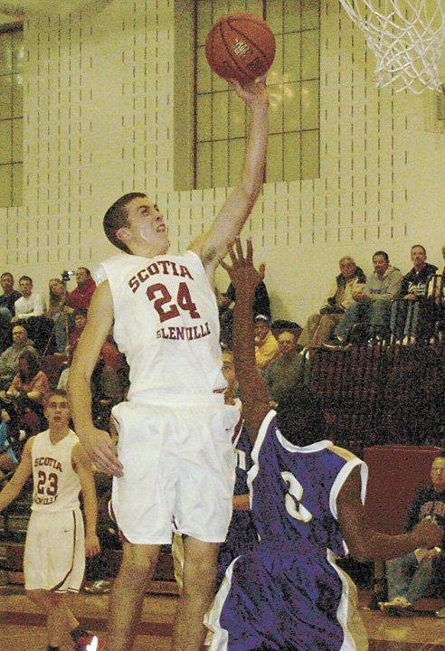 Scotia-Glenville's Joe Cremo soars in for a layup during Tuesday's Foothills Council opener against Johnstown.