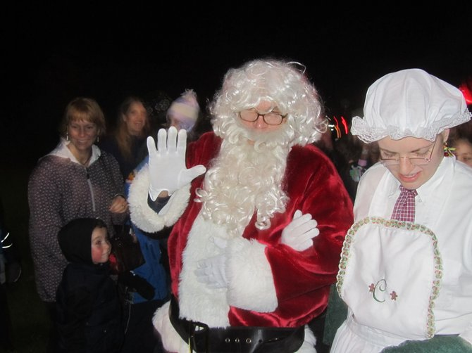 Santa waves hello in DeWitt. 