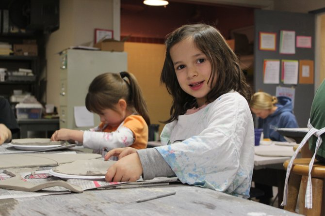 Lydia Palma, foreground, and Abby Reeder get ready to decorate their ceramic cookie plates at a holiday workshop at the North Country Cultural Center for the Arts in Plattsburgh.