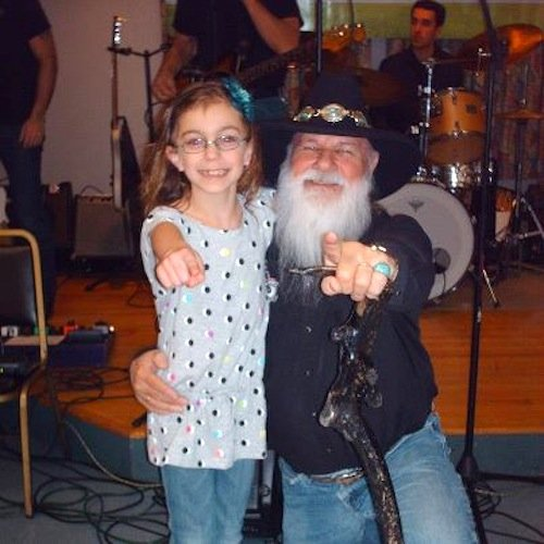 A Dec. 8 Vergennes concert, which brought together Vermont country stars for the benefit of Make-A-Wish, was a success, according to local organizer Jackie Rivers. Pictured are musician Jimmy T with local fan Arielle at the concert.