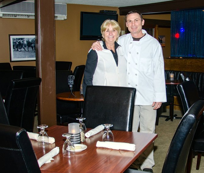 Head Chef Patrick Norton and Office Manager Patti Williams of Sam's Steakhouse and Prime Lounge.