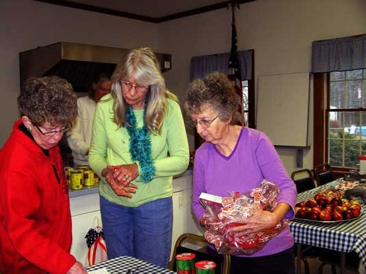 Assembling Christmas Baskets Dec. 8  for delivery in Thurman were Gail Needham, Paula Hubert and Karma Smith.