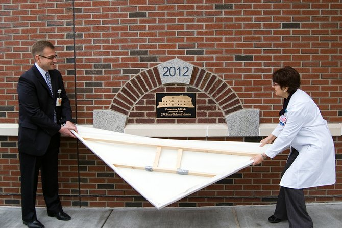 Ellis Medicine officials unveiled the cornerstone of the new Bellevue Woman's Center, which uses bricks and keystones preserved from the former mansion's frame.