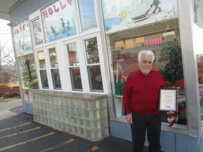 Sno Top owner Vince Giordano stands with his Forrest Mock Person of the Year Award in front of the store on Fayette Street in Manlius.