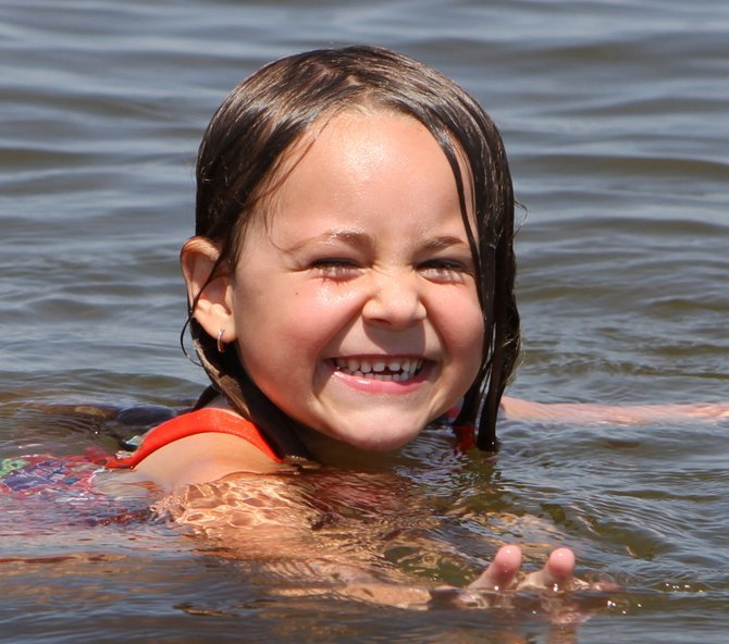 Kaylee Belden swims at Bulwagga Bay in the town of Moriah. Work to save the Bulwagga Bay shoreline will be completed in 2013.