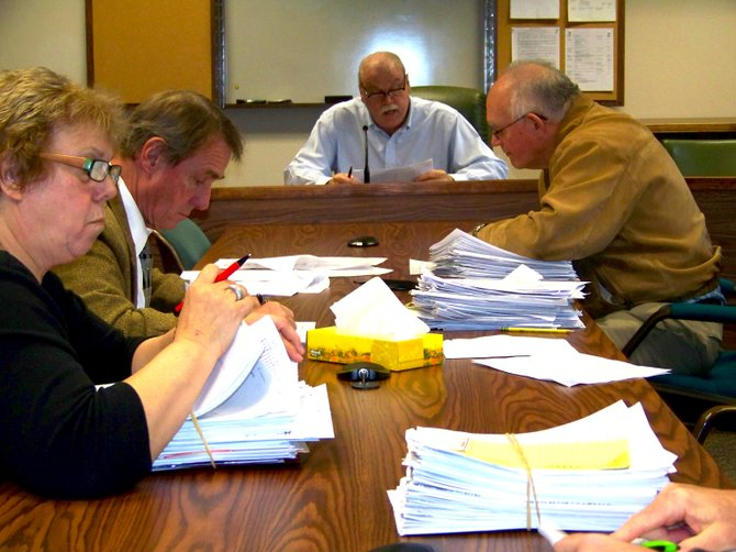 Among the Warren County supervisors reviewing occupancy tax grant applications Dec. 10 were  (clockwise, from left): Edna Frasier of Hague, Dennis Dickinson of Lake George, Bill Kenny of Glens Falls and Ralph Bentley of Horicon.  (Not pictured): ,Gene Merlino of Lake Luzerne, Mark Westcott of Queensbury and Ron Conover of Bolton.