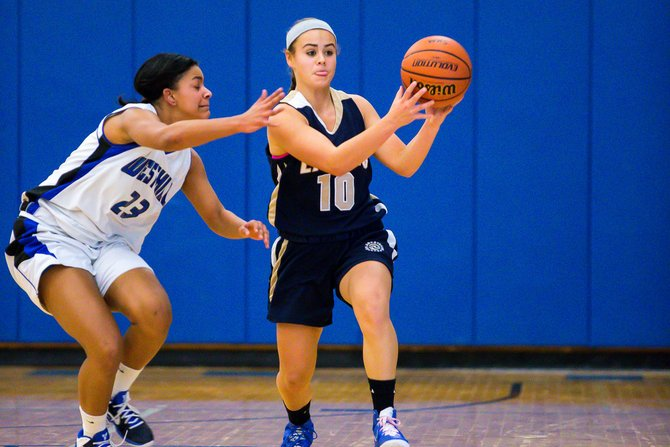 Skaneateles guard Nicole Beatson (10) is closely followed by Westhill's Anna Ross (23) as she dribbles up the court in Thursday night's game. Ross, in addition to her 19 points, managed several steals as the Warriors beat the Lakers 66-45.