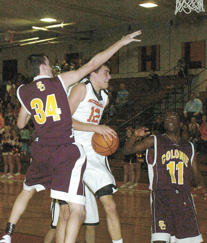 Bethlehem's John Sica is fouled as he goes in for a shot during Friday's Suburban Council South Division game against Colonie in Delmar.