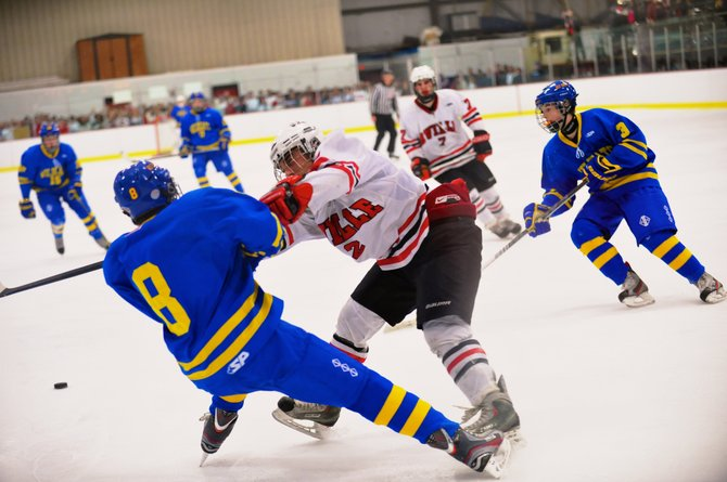 Baldwinsville defenseman Luke McCaffrey puts a hard check on West Genesee's Derek Farrell (15) during Friday night's game, a 3-0 loss by the Bees to the defending Division I champion Wildcats.