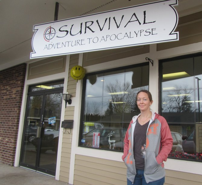 "Calypso Ford outside her new store in Fayetteville Square, ""Survival: Adventure to Apocalypse."""