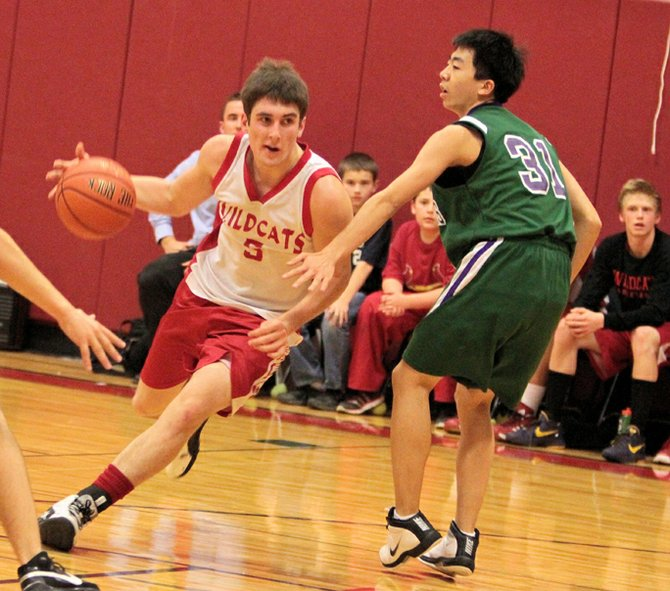 Schroon Lake's Jesse Shaughnessy drives past Minerva-Newcomb's Xian Zhao in Mountain and Valley Athletic Conference boys basketball action Dec. 14. Shaughnessy scored 29 points as the Wildcats won, 78-26.