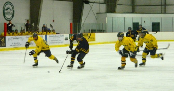 Cazenovia defensemen skate after a Skaneateles Laker headed for the net during the Dec. 11 match at the Morrisville IcePlex. Following the 7-0 loss to Skaneateles, the Cazenovia Lakers tied the New Hartford Spartans 4-4 on Dec. 15.