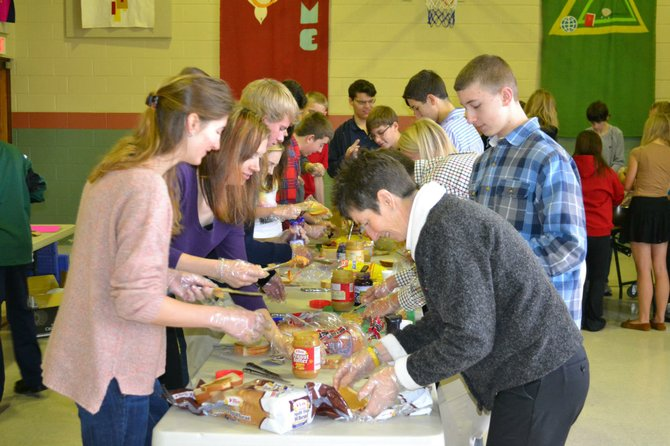 All ages from Good Shepherd help to make PBJ sandwiches and trail mix for the Rescue Mission to give to the homeless.