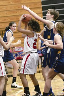 Cazenovia varsity girls basketball players surround an opposing player and prevent a shot. The Lady Lakers defeated the J-E Eagles 62-17 on Friday, Dec. 13.
