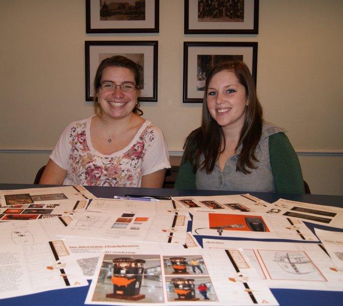 Cazenovia College Interior Design Program students Courtney Wallach, left, and Amanda Jones with materials from their kiosk presentation.