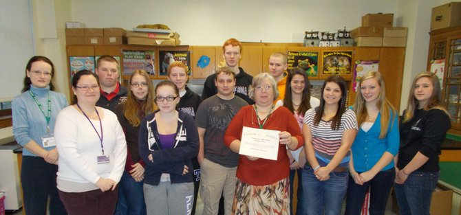 The Ticonderoga High School Student Voice has donated $100 to High Peaks Hospice. From left are Ingrid Roemischer, hospice development and outreach coordinator; Jennee Darragh, Student Voice adviser; Michael Watts; Karie Harrington, Samantha Sommerville; Mark Donohue; Dale Quesnel; Riley Chapman; TylaAnn Burger, hospice executive director; Jacob Crowe; Becky Barber; Alyssa Rodriguez; Kaitlin Diskin; and Michaela Conners.