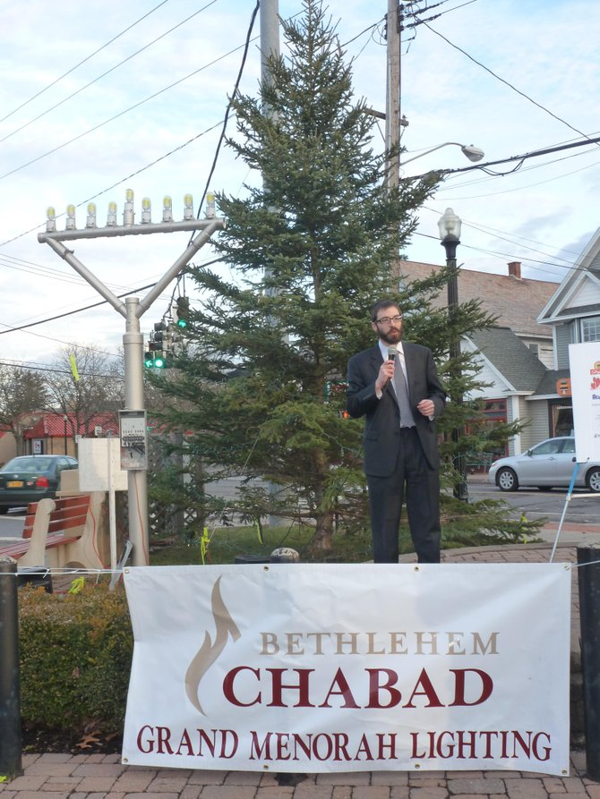 Rabbi Zalman Simon speaks at the Four Corners in Delmar before the lighting of the town's outdoor menorah, which is billed as the largest in the area.