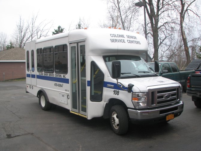 Vans can hold 12 passengers and the service runs about 80 trips a day.
