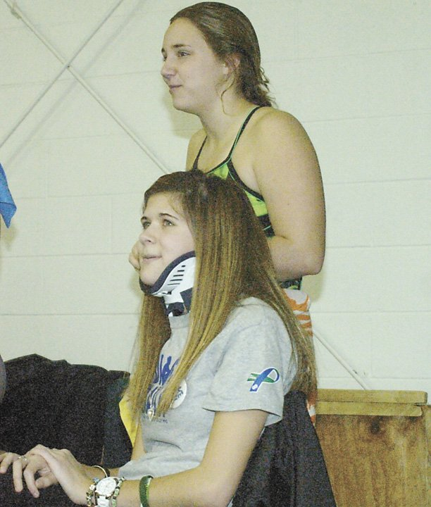 Shaker senior Bailey Wind watches the action at a dive-athon organized in her honor Sunday at RPI. Wind was one of two teens injured in a Dec. 1 accident on the Northway, which also claimed the lives of Shenendehowa student-athletes Chris Stewart and Deanna Rivers. Wind dove for Shaker in the fall and has a scholarship to the University of Tennessee.