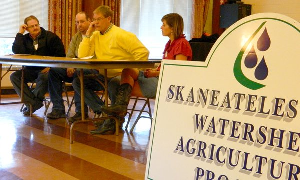 During the SLWAP annual meeting Dec. 11, a panel of farmers discussed 'green' Best Management Practices. From left, Brad Cates, Eric Brayman, Jim Greenfield and Erin Hull discussed soil management, cover crops and pest management.