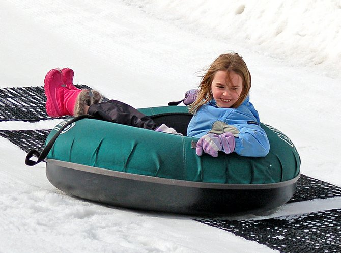 A student enjoys the Ski Bowl Tubing Park in February 2012.