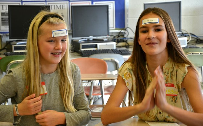 "Ivy Carter and Jessica Patalino react to the labels on their foreheads at the recent ""Be Cool, Not Cruel"" event at the high school. They don't know what their own labels say, but everyone else is treating them based on their labels."