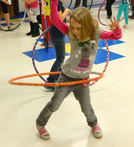 Second-grader Allison Shadle enjoys the hoola hoop she just made at the Girls Scouts' recent celebration of World Hoop Day on Dec. 12