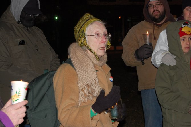 Mary Alice Shemo of People for Positive Action speaks at a candlelight vigil she organized in Plattsburgh in response to the massacre in Connecticut.
