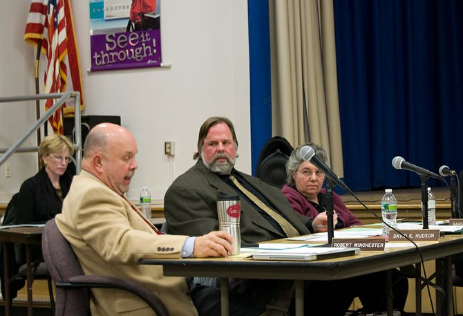 Niskayuna Board of Education member Robert Winchester, left, says the district didn't properly listen to concerns from community members on proposing to close Van Antwerp Middle School. The majority of board members on Tuesday, Dec. 18, supported moving any school closure as a last resort to achieve savings.