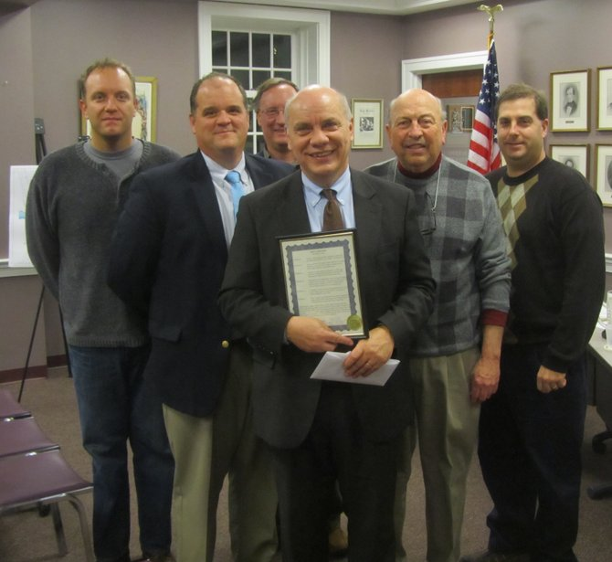 Tom Miller, center, poses with the Fayetteville Village Board at the Dec. 17 meeting. They are (from left): Chris Randall, Mark Olson, Mike Small, Dan Kinsella and Dennis Duggleby.