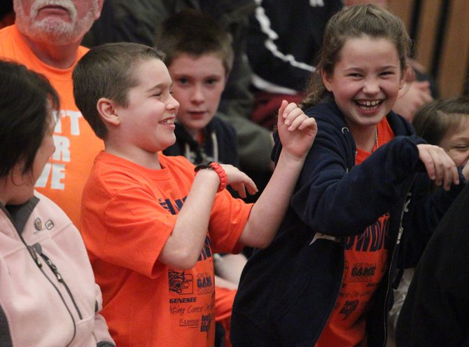 Parker Hysick and his sister, Madison, dance during Thursday night's Hoops for the Hospital fund-raiser boys basketball game at the Baker High School gym. Parker, the son of Baldwinsville 7/8 coach Ron Hysick, is in remission after a battle with leukemia, and the game, dedicated in his honor, raised more than $3,000 for Golisano Children's Hospital.