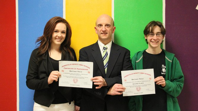 Jamesville-DeWitt High School Principal Paul Gasparini, center, with Shakespeare Competition winners Brittany Fayle, left, and Alex Leblond, right.