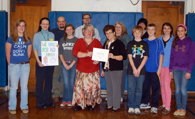 Members of Hospice thanked the students and faculty at Westport Central School for their donation of $600 for Hospice services. 
