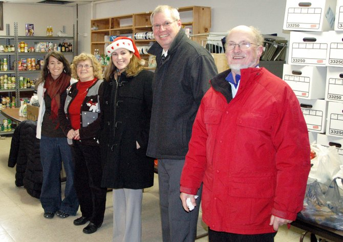 Willsboro-Essex Community Food Pantry workers Ashley Blanchard and Bev Moran are joined by Willsboro teacher Marie Blatchley, Superintendent Stephen Broadwell and board member Bruce Hale as the school was one of many groups to donate to the pantry.