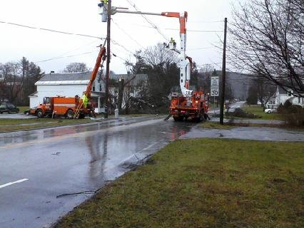 A Green Mountain Power utility crew work on damaged power lines on South Street in Castleton shortly after 1 p.m. Dec. 21.