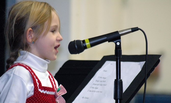 Kindergartener Casey Valentin recites her poem about animals during Westport Central Schools K-2 poetry reading Dec. 19. Students in the three youngest classes at the school each created and recited their own works for teachers, family and friends prior to the Christmas break.