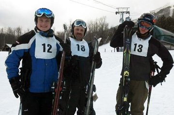 Special Olympians Michael Deouca, of Massachusetts, Bernie Medrazo of New York, and Zach Nelson of Washington State, train at White Face Mountain in Wilmington on Dec. 12.