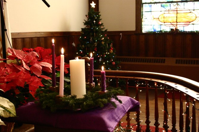 The sanctuary of the United Methodist Church in Warrensburg, decked out with traditional Christmas decor,  is depicted prior to worship service Sunday Dec. 23.
