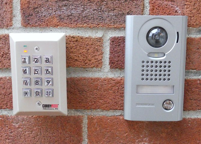 A security monitor in place at Warrensburg Elementary School allows school staffers to scrutinize each visitor before they are allowed passage through a locked  entry door. The device features a video camera that can zoom and rotate for full examination and identification of visitors, as well as two-way audio. A similar monitor exists at Warrensburg High School, minus the keypad at left which allows staff members entry by punching a passcode.