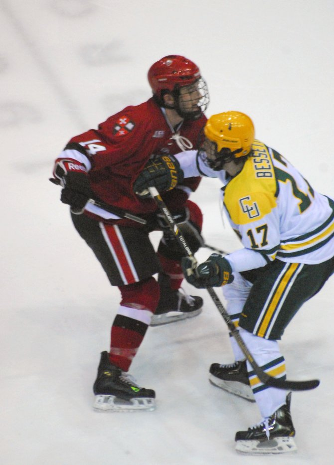 Carter Franz, left, a native of Cazenovia, collides with a player from Clarkson University during a recent match at St. Lawrence University. Franz was asked to help out as a practice player for the team when the coach realized the roster was short.