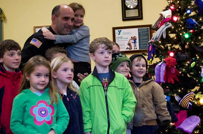 Schenectady County Sheriff Dominick Dagostino and department staff, on Wednesday, Dec. 19, presented donated gifts to families in need at the Glenville YMCA.