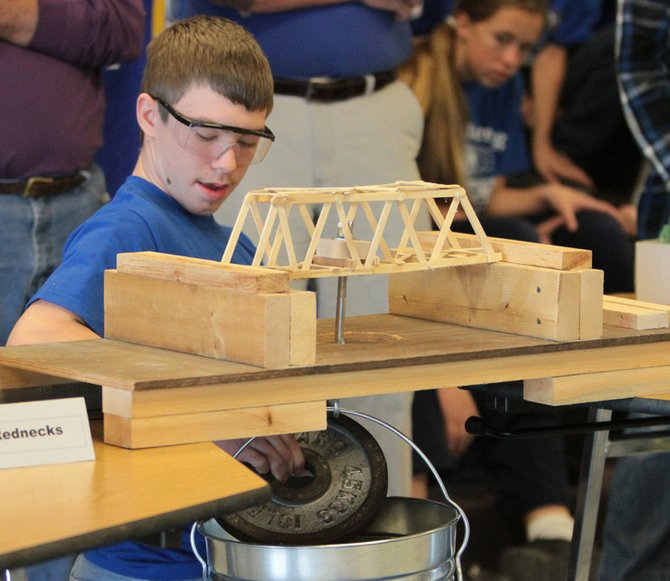 Team Big Buck of Ti Middle School was the most efficient middle school bridge, carrying a record load of 170 pounds at the annual Ticonderoga Kiwanis bridge building contest. Trevor Parent constructed the span.
