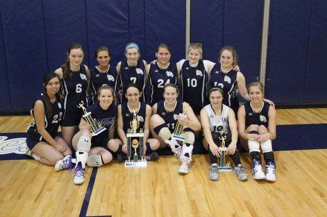 Jordan-Elbridge's girls volleyball team with the first-place trophy earned at the volleyball tournament it hosted on Dec. 28. Front row, from left: Samantha Ryan, Olivia Simmons, Kim Oliver, Kali Kimak (tournament MVP), Brienna Fabrize, Ashley Hamlin. Back row: Melissa Perkins, Jenna Ashby, Cassidy Fletcher, Ashley Wixson, Sabrena Hawker, Mackenzie Mannion.