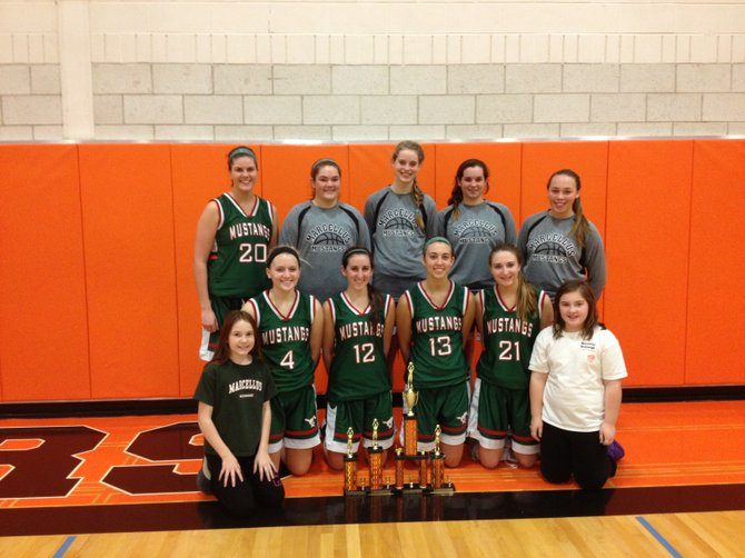 The Marcellus girls basketball team won the Dec. 28-29 Mexico Christmas Tournament, beating Carthage in the first round and host Mexico in the finals. Front row, from left: ball girls Samantha Wynne and Emma MacLachlan. Middle row: Meghan Witkowski, Tessa Mosher, Molly MacLachlan, Nicole Wynne. Back row: Lauren Soule, Shelby Nye, Erica Balman, Rylie Spicer, Morgan DeLand.