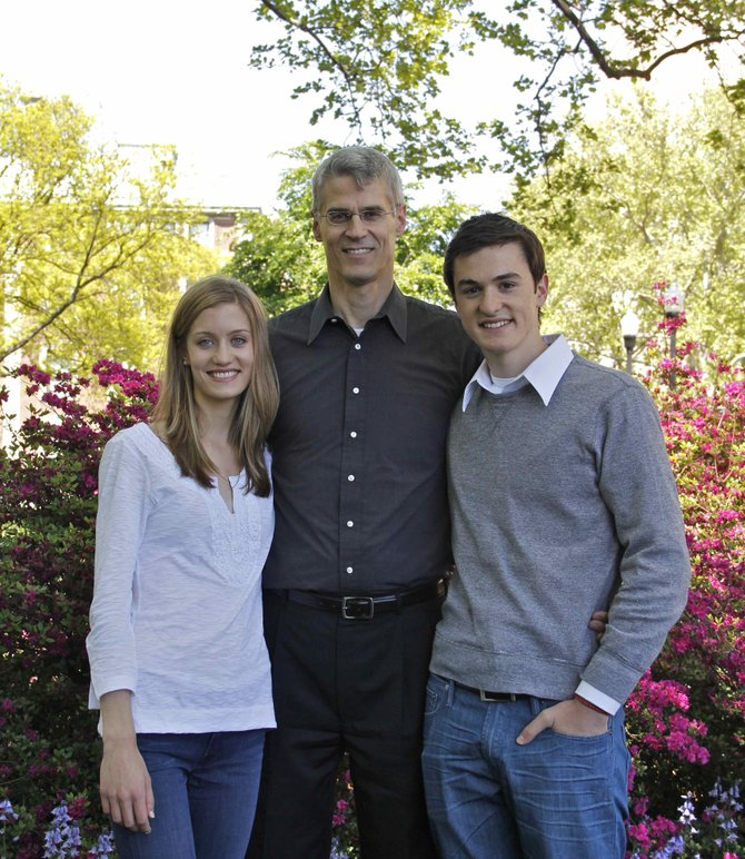 Karl Zinsmeister, center, stands with his children Kate Harvey and Noah Zinsmeister. The trio recently released their new book Finger Lakes Feast, a collection of recipes and essays inspired by the food culture of the Finger Lakes region.