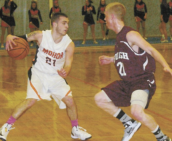 Mohonasen's Nick Rapp, left, tries to dribble around a Lansingburgh defender during last Friday's Kirvin Cup Tournament championship game.