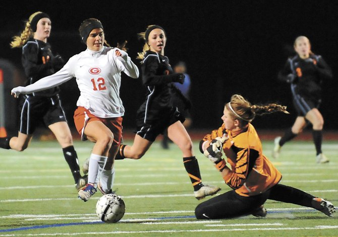 Guilderland's Laurie Knapp (12) charges in on Bethlehem goaltender Katie Nickles during the Section II Class AA finals.