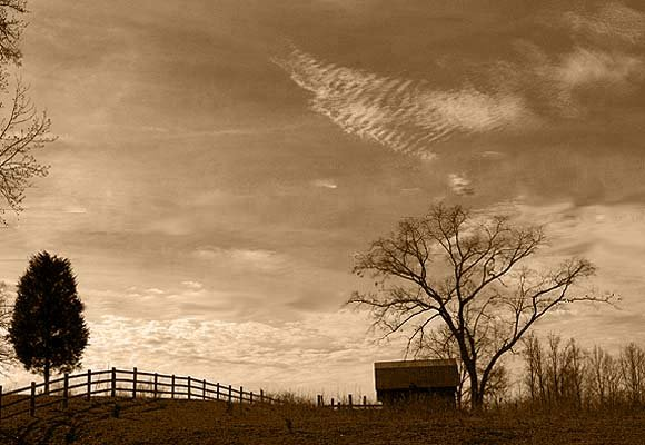 """The sentiments conjured up by """"home"""" evoke the desires for peace and security, enjoyed only in the womb. Pictured: An abandoned barn along Route 221 in Rutherfordton, N.C."""