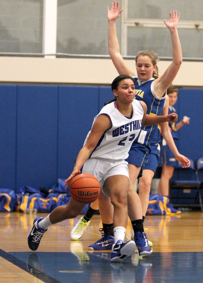Westhill junior guard Anna Ross (23) dribbles past Cazenovias Kaitlyn Gerber on her way to the basket in Thursdays game. Ross put up seven straight points to ignite a decisive 18-0 run as the undefeated, state Class B no. 2-ranked Warriors beat the Lakers 49-39.