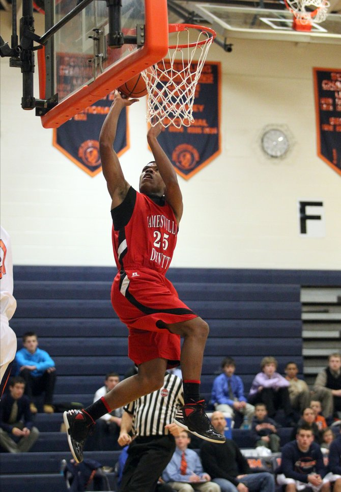 Jamesville-DeWitt forward Jafar Kinsey (25) flies to the basket and converts in Friday night&#39;s game against East Syracuse-Minoa. Kinsey led the Red Rams to a 66-54 victory over the Spartans, finishing with 23 points.